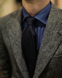 Blue oxford shirt and navy grenadine tie.