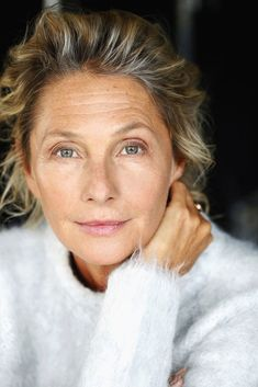 """""""Model Wookie Mayer turns sixty this fall. Aside from her obvious good genes and bone structure, I think a lot of her beauty comes from her natural style – unfussy hair, toned body, minimal makeup. I'm taking note of the less is more approach…let skin show through a lightly bronzed face, add color to lips, keep eyes bright and natural. A few wrinkles actually look appropriate and add to her appeal."""""""