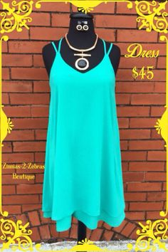 Little Slip Dress with a modern twist! Every girl needs this dress in her closet!!! $45. S-M-L