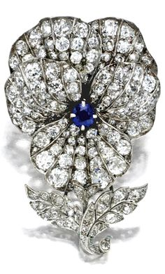 DIAMOND AND SAPPHIRE BROOCH, TIFFANY & CO., CIRCA 1880 The cushion-shaped sapphire weighing approximately .70 carat, old mine, old European-cut and single-cut diamonds weighing a total of approximately 10.00 carats, signed Tiffany & Co.