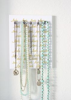 How to make your painted canvas art into a necklace organizer.