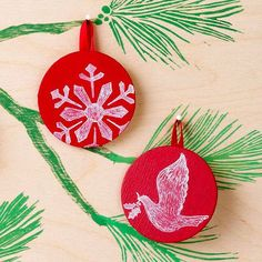 Go old-school this Christmas with mini chalkboard ornaments. Start by coating unfinished wooden discs in red paint, then let your creativity wander with fun and festive chalk designs. Think snowflakes, doves -- even a vintage Santa face!/