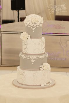 The white lace effect on the gray wedding cake is so beautiful