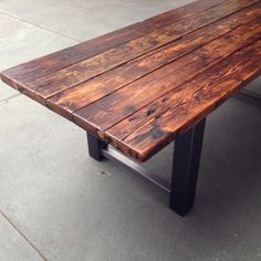 Reclaimed Wood and Metal Dining Table - The douglas fir was reclaimed from a 1930's water tower in Encinitas, CA. Years of exposure to the coastal air has given this wood unique character. We have combined the reclaimed wood with 4 inch wide raw steel bases to give this dining table an industrial and modern look.