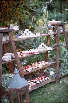 dessert display on wood ladders with plank shelves / http://www.deerpearlflowers.com/wedding-food-bar-ideas/
