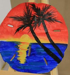 This sunset is painted with acrylic paint on a sand dollar and comes with easel and gift box.