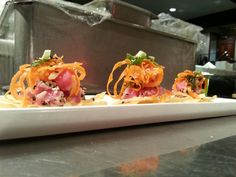 Ahi tuna nachos - wonton crisps, sesame seared tuna, carrot ginger slaw  & yuzu gastrique