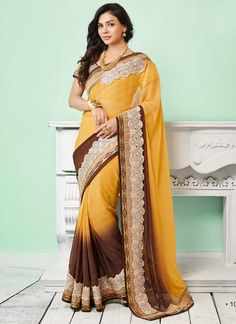 Best  Amazing Brown And Yellow Georgette Embroidery Indian Designer Saree at unbelievable rates From Uttamvastra