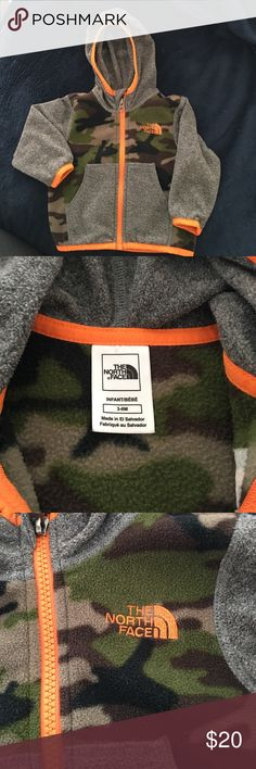 Kids North Fleece Hooded Jacket Adorable North Fleece Camo pattern, hooded fleece jacket. So easy to take on and off. Cute orange trim. Comes from a smoke free home. Only worn a couple of times. Like new condition! North Face Jackets & Coats