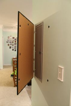 Hang a Frame on Hinges to Conceal an Electric Box - Charleston Crafted