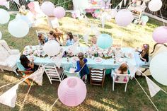 Guests Dining at a Shabby Chic Alice In Wonderland Birthday Party via Kara's Party Ideas KarasPartyIdeas.com (8)