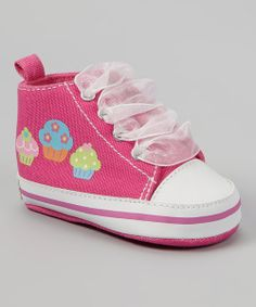 There'll be no stopping a little one on the go once they start playing in these sweet sneakers! Decked out with darling graphics and organza laces, this pair adds style to any miniature ensemble.Lace-upMan-madeImported