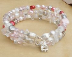 Handmade bracelet made with memory wire. All spacer beads and findings are sterling silver.  All precious and semi precious stones and gems. Different coloured cultured potato pearls, Crackle Quartz, Rose Quartz.