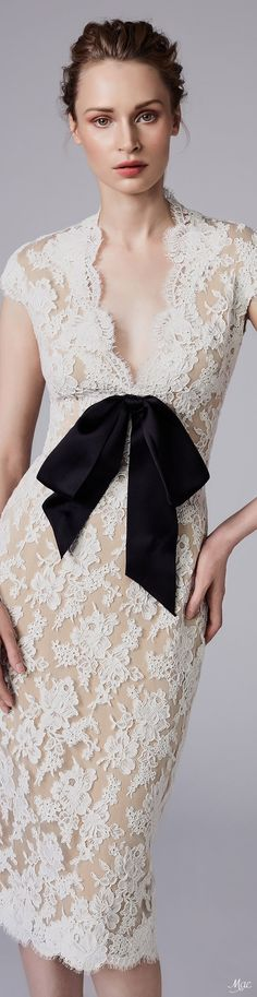 I prefer more modest necklines, but I love the lace and the bow.