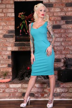 Size 4x Turquoise dress- Bettie Page / shopping time (runs quite small like a larger 2x or small 3x IMO and the fabric does stretch)