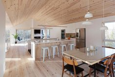 Let's have a look at a residential house by DKA Architects built in the Laurentians. Designed by DKA Architects, this residence is hidden by a curtain of Garage Apartment Plans, Garage Apartments, Dining Area, Kitchen Dining, Saint Sauveur, A Frame Cabin, Forest House, Space Architecture, Cuisines Design