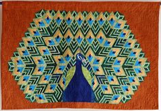 Natural Beauty by Helga Mayr.  The peacock feathers are constructed with log cabin blocks. Galerie   Patchwork Gilde Austria
