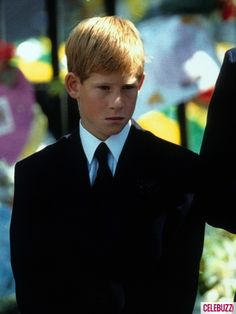Prince Harry stands outside Westminster Abbey at the funeral of his mother Diana, Princess of Wales on September 6, 1997 in London, England.