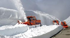 Snow plows clear a road in Graubuenden, Switzerland, on Monday 4 June 2012.