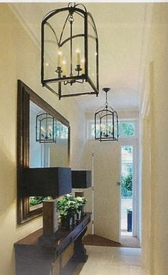 Loving the pendant lights, beautiful entryway