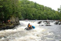 This is a pinned raft.  Our Maine whitewater raft guides are trained to deal with pins when put into this type of precarious situation.  Take a swiftwater rescue course with Northeast Whitewater to understand how to deal when a rock holds your boat.