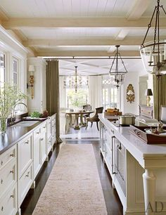 I prefer this to peninsulas,,. one aisle between sink and island; and  another aisle between island and stove & fridge.