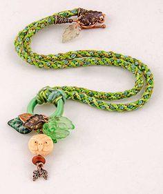 He encontrado este interesante anuncio de Etsy en https://www.etsy.com/es/listing/209341788/mother-nature-amulet-necklace-hand-made