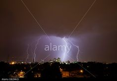 London, UK. 23rd July, 2013. Lightning strikes over London with the Docklands lit up in front. © Vitor Da Silva/Alamy Live News