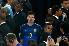 A dejected Lionel Messi of Argentina looks on after being defeated by Germany 1-0 in extra time during the 2014 FIFA World Cup Brazil Final match between Germany and Argentina at Maracana on July 13, 2014 in Rio de Janeiro, Brazil.