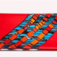 Fused and slumped glass tray in orange and turquoise. Sheets of art glass are created and fired, then cut and assembled to create this tray