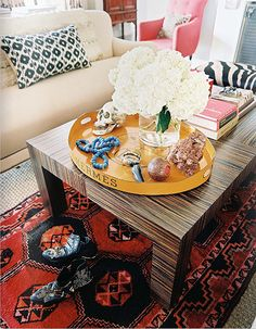 Tribal rug and grained coffee tables.