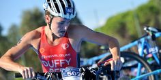 XTERRA World Champion Flora Duffy (BER) exits T1 with the lead.