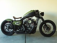 Harley Nightster bobber. The flat green goes w the matte black so well! #harleydavidsonbobbecaferacers