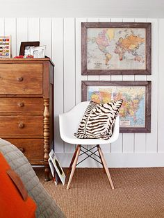 Barn board framed maps. Vertical board walls. Modern chair and zebra print. The contrasts make this space so successful.