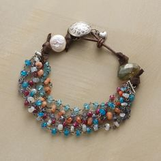 """BON VIVANT BRACELET--In this labradorite, pearl and gemstone bracelet, a faceted labradorite and a luminous freshwater pearl stand to the side with strands of gems: sunstone, moonstone, apatite and tanzanite. Leather loop and sterling silver button closure. Exclusive. Fits 7-1/4"""" to 8"""" wrists."""