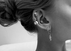 multiple piercings in black and white