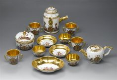 Parts of a coffee, tea and chocolate service with chinoiserie and the coat of arms of Elisabeth Farnese, Queen of Spain. Meissen, 1728
