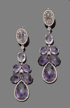 A pair of amethyst, pink sapphire and diamond pendent earrings The pear-shaped faceted amethyst within a brilliant-cut diamond border, suspended from five oval faceted amethysts, to a similarly-cut amethyst and diamond surmount, with circular-cut pink sapphire highlights, diamonds approx. 0.80ct total, length 7.2cm