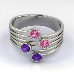 With elegant and modern design this ring features four 3.1mm brilliant cut stones. It looks like there are multiple rings, but in fact its just one! As shown in 14K White Gold with Pink Sapphires and Amethysts.