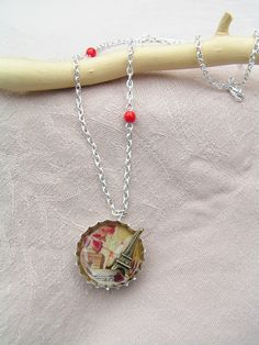 Miniatura - Paris necklace in silver bottlecap with the bourbon lily in the back side, compleated with some perfect red coral bead.
