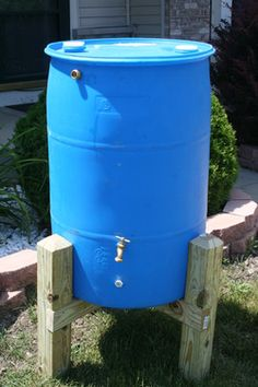 How to paint rain barrels the rain barrel stand is made for Rain barrel stand ideas
