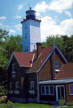 Located in a beautiful state park on Presque Isle Peninsula, this lighthouse dates from 1872. Most guide books say that the 68 foot tower shines light from a modern optic which replaced the original fourth order Fresnel lens, but the light in the tower appeared to be a Fresnel when I visited in 1999. The Coast Guard still maintains the light, but the keeper's house now serves as a residence for park employees. The grounds are off-limits to park visitors, but you can get an excellent view by…