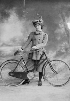 """1888 Female cyclist posing with one of the newfangled """"safety cycles"""" (with rubber rather than metal tires)."""