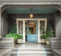 DIY décor: Paint the porch ceiling an unexpected shade of teal to compliment the front door.