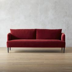Shop ronan wine sofa.   We partnered with furniture designer James Patterson to come up with a sophisticated, modern sofa in an eye-catching color that won't break the bank.