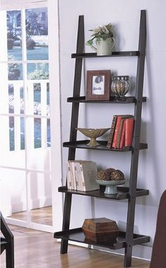 This uniquely shaped display cabinet gives a modern twist to the classic bookcase design. Equally intriguing as a vertical or a horizontal display, this wood bookcase features a variety of shelf sizes