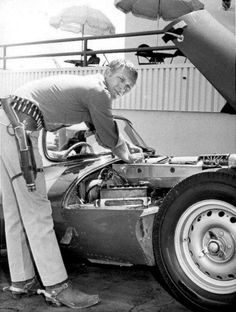 Steve McQueen working on is Jaguar XKSS