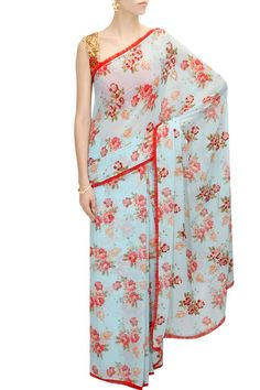 Blue floral print embellished sari with red embroidered blouse available only at Pernia's Pop-Up Shop.
