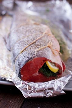 Learn how to cook whole salmon in the oven, the easy way! This healthy recipe for whole salmon stuffed with lemon & herbs makes wild caught low-mercury salmon an affordable option. Baked Salmon Recipes, Seafood Recipes, Cooking Recipes, Healthy Recipes, Keto Recipes, Cleanse Recipes, Cooking Games, Oven Recipes, Healthy Dinners