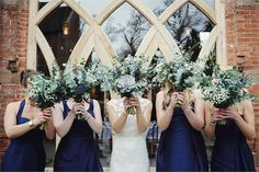 Wow. These bouquets are gorgeous aren't they? We really like how green and leafy they are. Sometimes flower-heavy bouquets just don't suit the bride's vision and this is a fabulous example of how amazing greener bouquets can look. The picture is pretty awesome too…